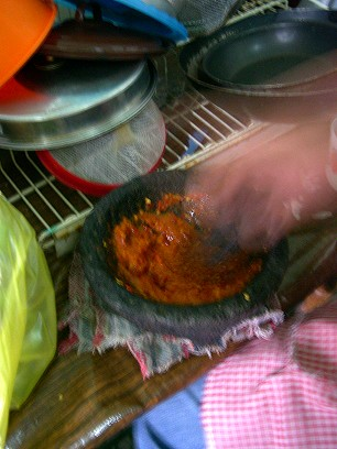 """A molcajete is a bowl carved from volcanic basalt.  Food is ground with a hand held tejolote, or stone """"doll.""""  It is a lot of work, but the salsa tastes great"""