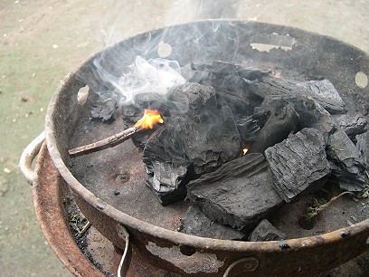 And fires up the grill with a splinter of resinous wood