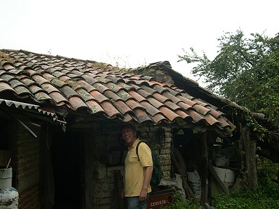 The house is adobe, with a tile roof.