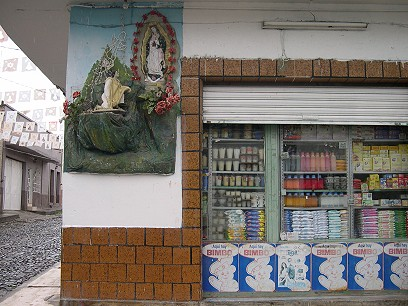 The Virgin of Guadalupe on a corner store.  Note the Bimbo Bear advertising Mexico's most popular bread.