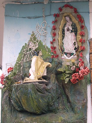The Virgin of Guadalupe presents her image to Don Juan Diego on his tilma, which is filled with out-of-season roses.  Angels light up at night.  This image is instantly recognizable to all Mexicans.