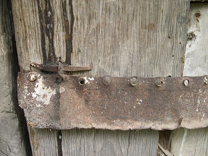 The door is held together by old saw blades.  Nothing goes wasted here
