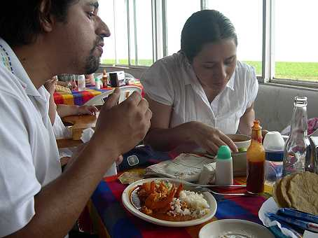 "Pablo has shrimp ""al Diablo"" (in hot sauce) and Silvia is polishing off some fish soup (caldo michi--michi means fish in the native tongues of both Michigan and Michoacan!)"