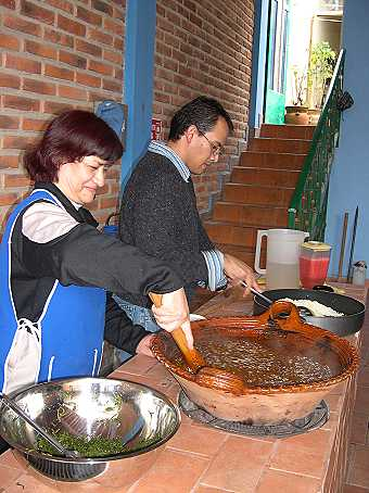 Omar's Mom stirring her home-made mole.  The green romeritos will be mixed in soon.