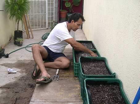 Omar prepares the beds...