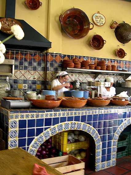 Inside is a traditional Mexican kitchen, all tiles and clay bowls, where you can watch your lunch being prepared.