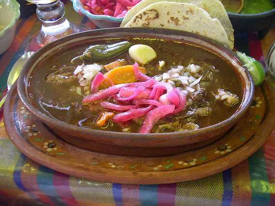 Heaven.  A plate of birria, pickled vegetables, and tortillas hot off the comal.  The caldo or broth is so full flavored it will take your breath away.  Oh--and speaking of breath--whole garlic cloves?  Oh YES!   They are buttery smooth and not as garlicy as you might think, with a potato-like texture.