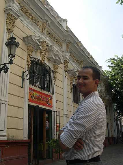Omar just loves his filials and curlicues, but he is smiling because he knows Nueve Esquinas is famous for goat stew.