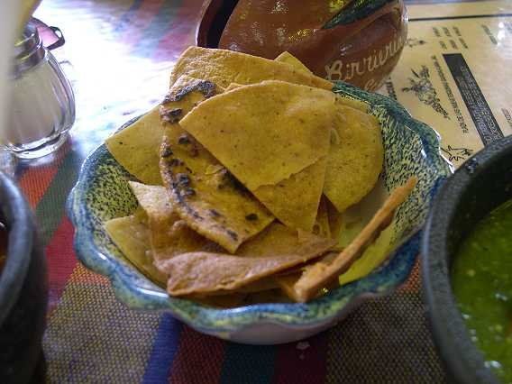 The sauces and beans are ably transported from bowl to mouth on totopos--triangles of deep-fried corn tortillas.  Fried in manteca (lard) of course.  The diet can resume when you go back home.  They are delicious.