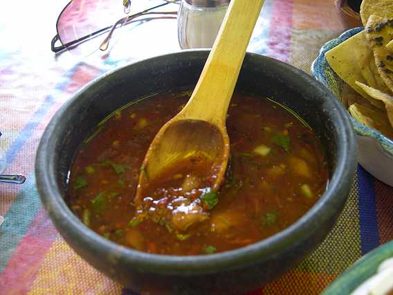 Red sauce with cilantro.  This sauce has some tomatoes in it (and plenty of tomatillos and cilantro) along with chile.  Other red sauces are hot peppers and tomatillos, without the tomato.