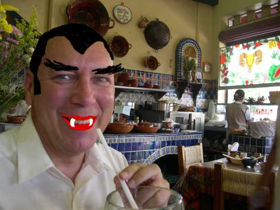 """Some folks report strange effects from eating so much garlic, but we sure aren't effected.  This is for all of you who wrote in asking what I would look like with hair.  No extra points if you can name our favorite actor. (Omar says he is the only thing that can cure his insomnia.  I say if I have to listen to Madonna, he can stay awake through """"White Zombie."""")."""