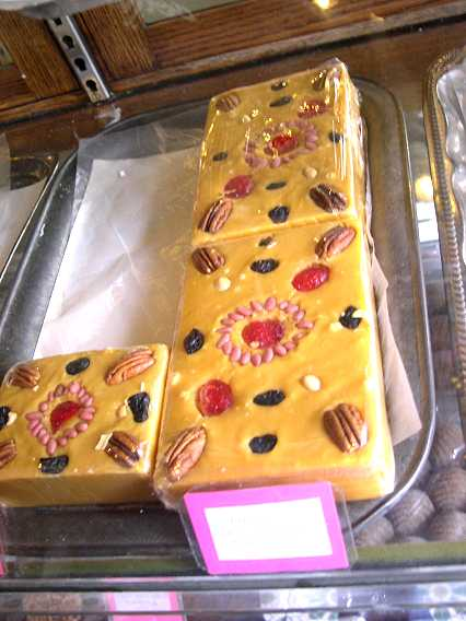 What gorgeous creations--this is a fudge-like confection topped with fruit and pink piñon nuts.