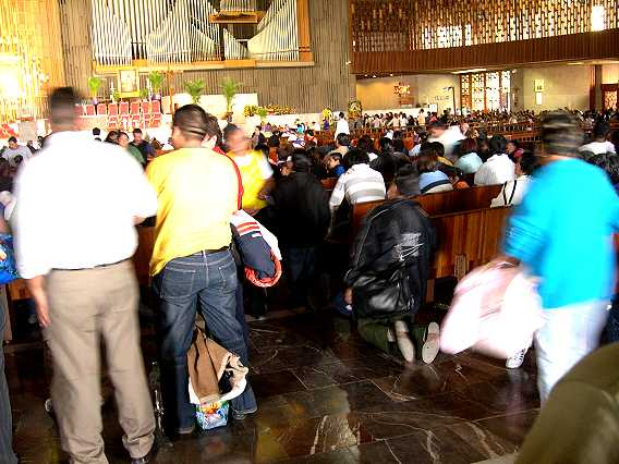 The basilica is often packed to overflowing, with many crossing the wide patio and entering on their knees.