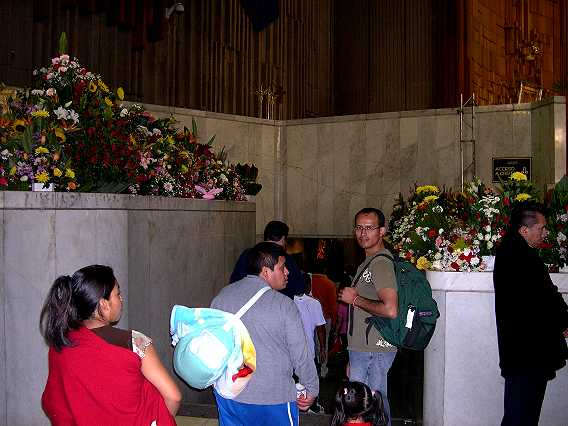 To visit the Virgin close up, you pass under the altar (which sits upon a crypt).  There are always lots of flowers.