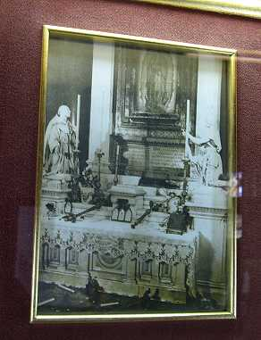In the 1920's someone snuck a bomb into the basilica and it exploded in front of the image of the Virgin.  Although the heavy metal crucifix was bent backwards, the image was not harmed.