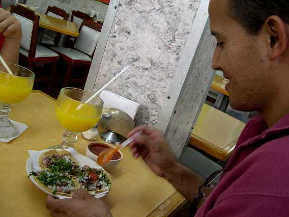 Omar embellishes his tacos with tasty add-ons...