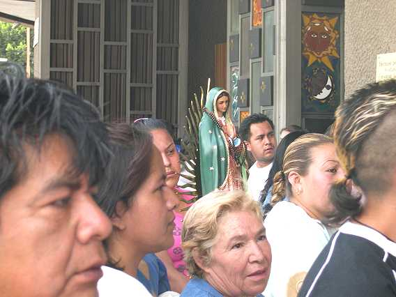 Everyone from senior citizens to punk rockers came, some carrying their statues and photos of the Virgin.