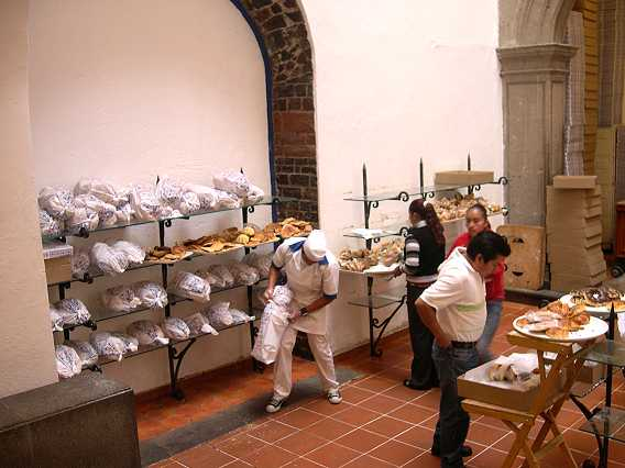 There is a sunken area where bread and rolls are sold, often in bulk.