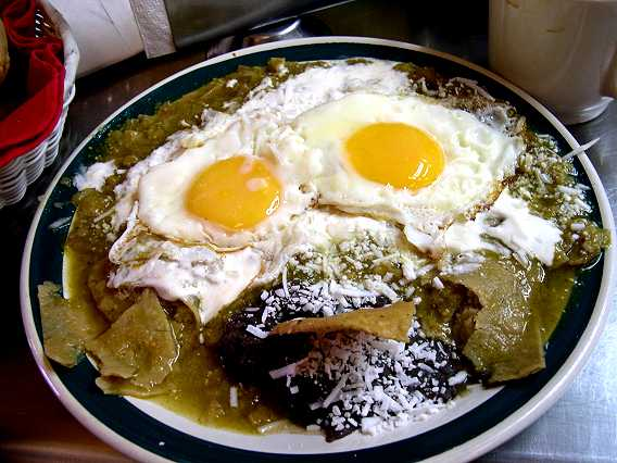 Another plating.  Looks like Netzahuacoyatl is sticking his tongue out.  He is showing what he thinks of our caloric intake.  Chilaquiles can also be made with red sauce, or chile poblano/cream sauce, mole. or even mango/habanero sauce.  They are the perfect breakfast.