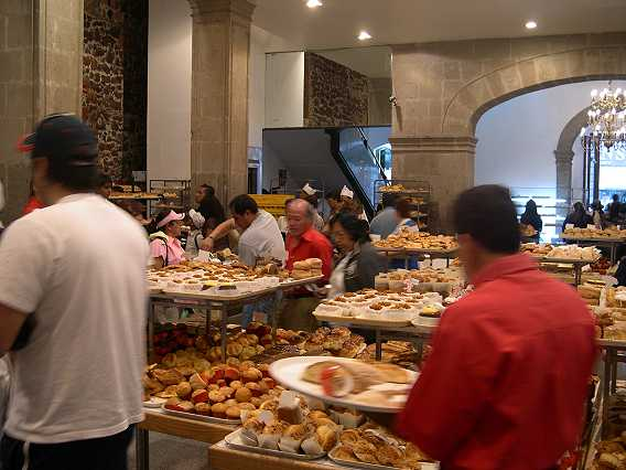 Back downstairs, things are heating up.  Lots of people, all in a hurry to get their pastries.