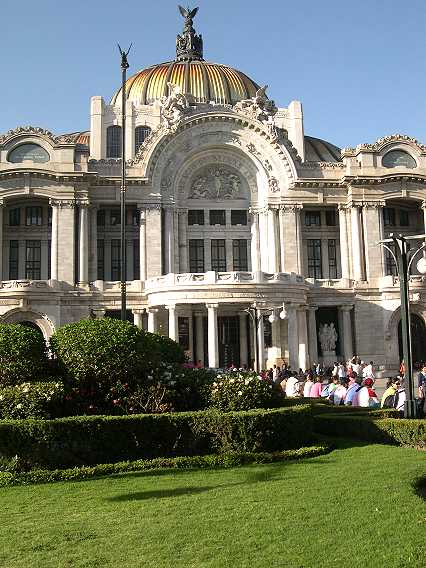 All throughout the Centro Historico are new plantings and scrubbed facades, but none are prettier than here in Bellas Artes.  Under the dome is the theater, with a stained glass curtain by Louis Comfort Tiffany.  It is a scene of the Mexican countryside.  By the play of the lights, the scene goes from sunrise to mid-day to sunset--and then the entire curtain swings up into the roof, and the function begins.  It is extremely impressive.