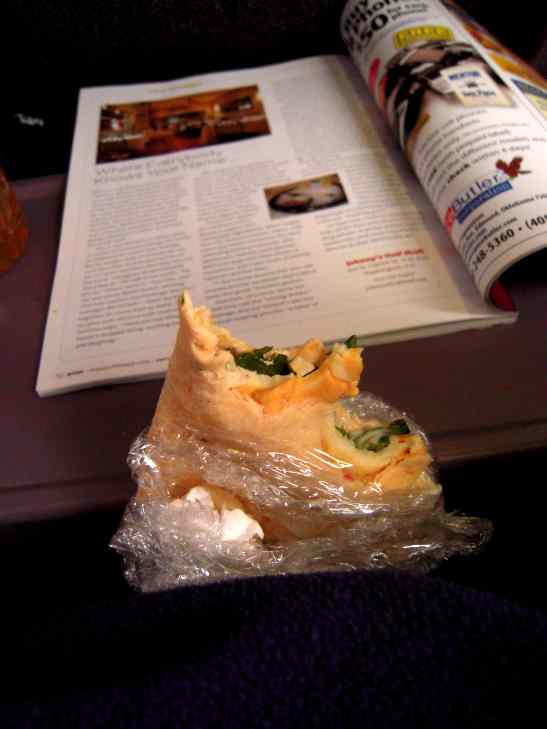 Cozy and warm inside, with a veggie-humus wrap and a magazine.  Heaven.  I am now packing food wherever a travel--it is invariably better than the chips and soda for sale at outrageous prices.  Potato chips on the plane were going for $3.  Yeah, right.