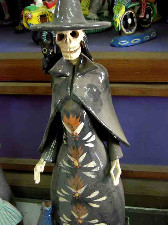 There are witch Katrinas, too, but this is a cheat.  We don't celebrate Halloween (Jaloin) in Mexico, except as a gringo holiday (like you might go to a Cinco de Mayo party).  You can see that this poor gal is less popular--she's very dusty.