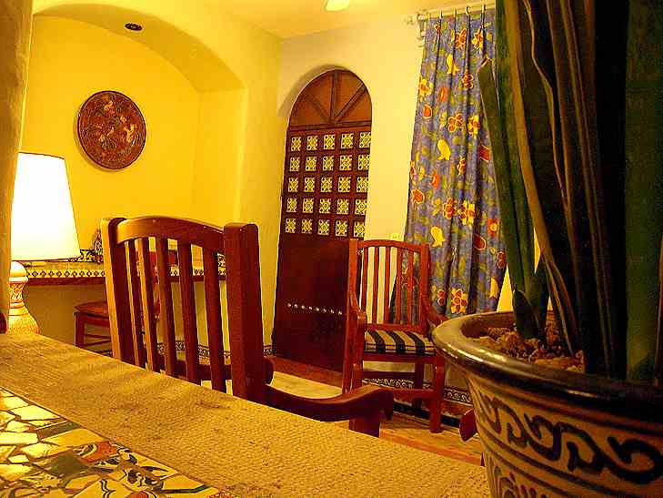 Our good-size room has a cozy sitting area and a beautiful tiled door.